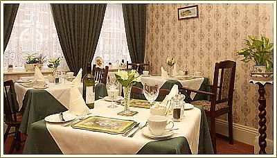 Dining room with individual tables for delicious full English breakfasts and evening meals