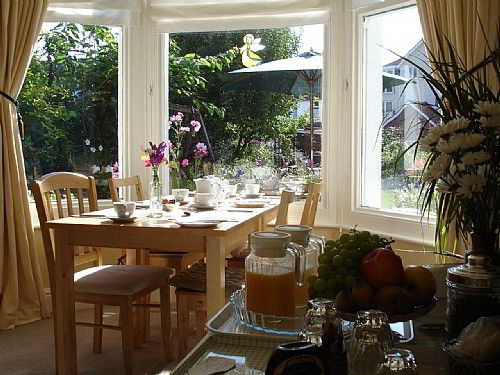 Enjoy breakfast in our sunny Breakfast Room while looking on to the garden