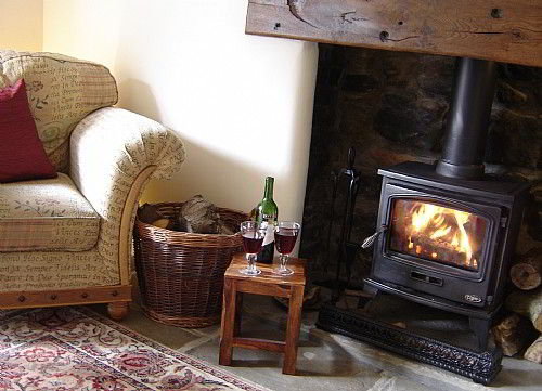 The guest lounge with log burning stove