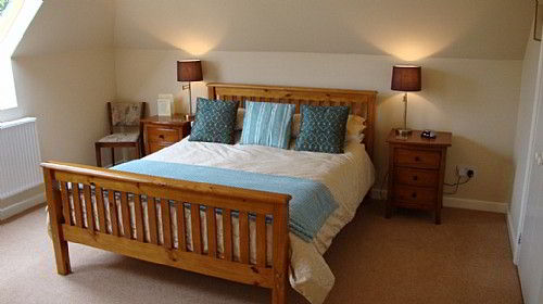 Our double bedroom with king size bed and en-suite bathroom
