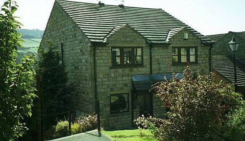 A traditional stone built house overlooking the picturesque Holme Valley