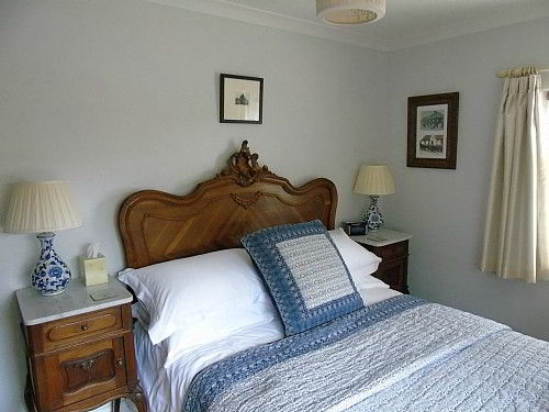 Bedroom Two - cosy with antique furniture throughout