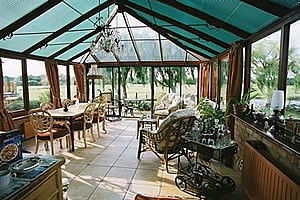 Relax in the open conservatory overlooking the meadows